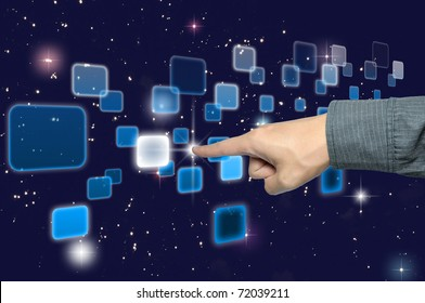 hand pushing a button on a touch screen interface under starry night sky