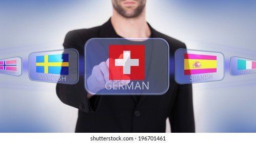 Hand pushing on a touch screen interface, choosing language or country, Switzerland