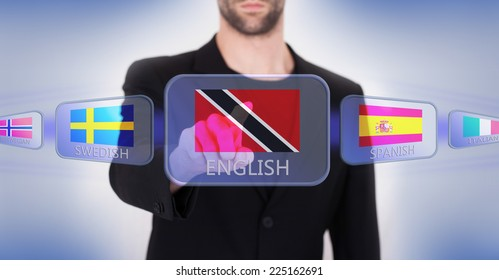 Hand pushing on a touch screen interface, choosing language or country, Trinidad and Tobago