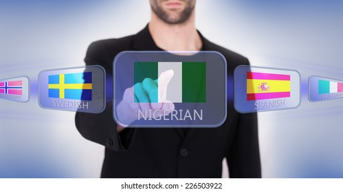 Hand pushing on a touch screen interface, choosing language or country, Nigeria