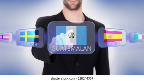Hand pushing on a touch screen interface, choosing language or country, Guatemala