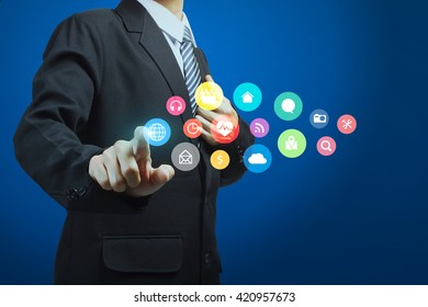 Hand pushing on a touch screen interface modern social buttons applications icons