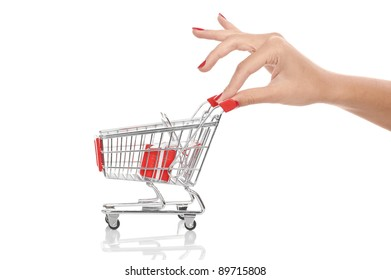 A hand pushing a red shopping cart isolated on a white background.