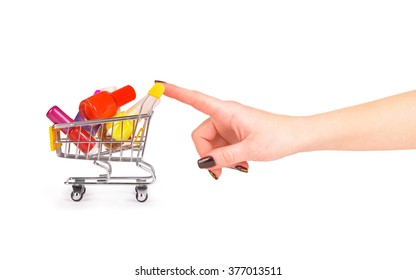 hand pushing wheelbarrow with nail polish isolated on white