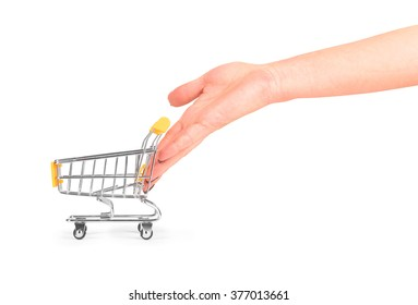 hand pushing a wheelbarrow for products