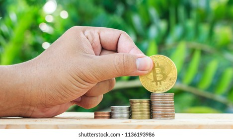 Hand put coin to money. Making money. For business and finance concept.