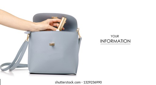 A hand put cosmetic in the female blue gray leather handbag pattern on a white background isolation
