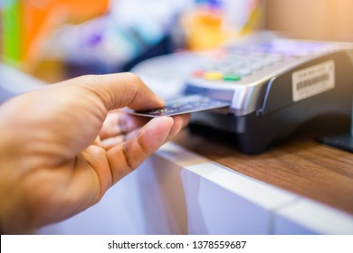 Hand put credit card In slot of credit card reader, credit card payment, buy and sell products & service, the concept of payment without cash, selective focus.