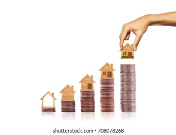 Hand put house model on row of coins stack. finance and banking. Concept for property ladder, mortgage and real estate investment. Investment and business growth concept
