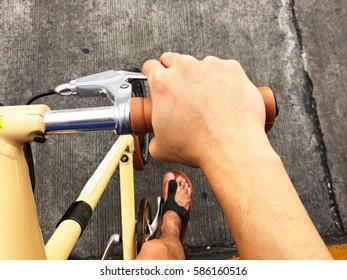 hand put on bicycle handlebar pressing brake lever