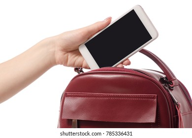 A hand put the phone in the female handbag on a white background isolation