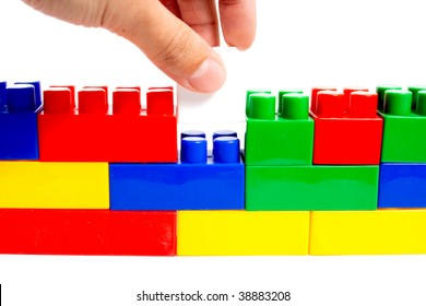 hand putting block of constructor