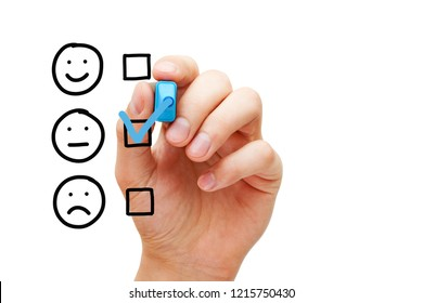 Hand putting check mark with blue marker on blank average customer survey evaluation form isolated on white.