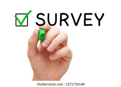 Hand putting check mark on Survey with green marker on transparent wipe board isolated on white.