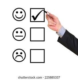 Hand putting check mark on customer service evaluation form