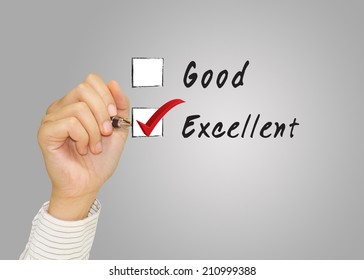 Hand putting check mark with red marker on excellent credit score evaluation form.