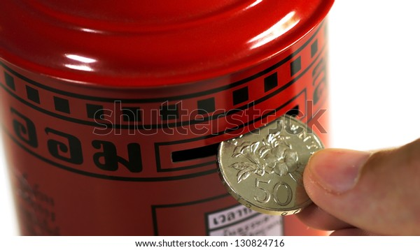 Hand Putting Coin into a Post Box Piggy Bank
