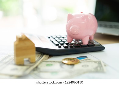hand putting coin money to piggy bank saving, save money concept.Real estate sale, home savings, loans market concept.