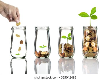 Hand putting gold coins into clear bottle on white background,Business investment growth concept - Shutterstock ID 335042495
