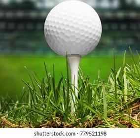 Hand putting golf ball