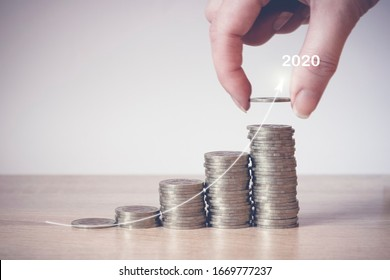 Hand putting money coin on line rising, virtual hologram statistics, graph and chart with arrow up on light background. Stock market. Business growth, planing and strategy concept. Digital marketing