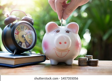 hand putting money coins in piggy saving for concept investment mutual fund finance and education
