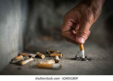 Hand putting out a cigarette,cigarette butt