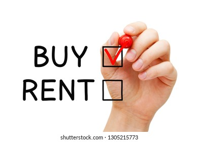Hand putting red check mark on Buy expressing the choice to buy not to rent real estate or other property.
