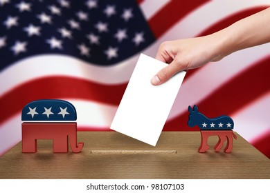 Hand putting a voting ballot to wooden box on Flag of USA, party icon