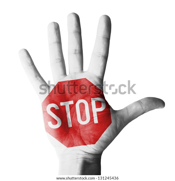 Hand raised with stop sign painted - isolated on white background