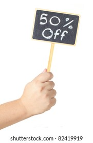 Hand raising a blackboard display 50% off discount sign  isolated on white background