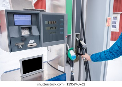 Hand raising fuel nozzle with self-service in petrol station