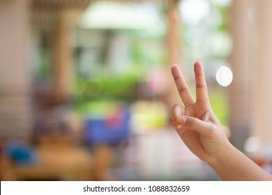 Hand raising two fingers