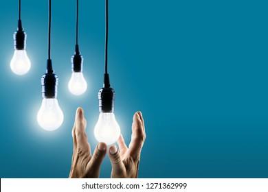 Hand reaches for lightbulbs