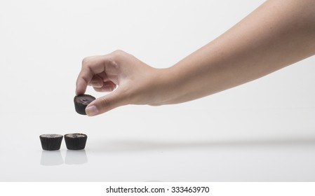 Hand Reaches for Peanut Butter Cups