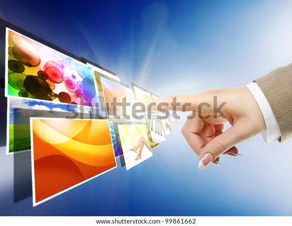 hand reaching with the finger images streaming from the deep over sky blue background
