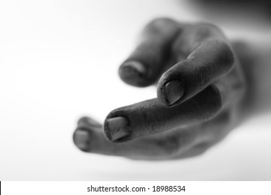Hand reaching for help, special close up focused  cracked fingers with grunge texture signifying frustration and powerlessness
