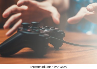 hand reaching for the joystick. concept of video games addiction