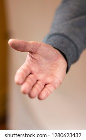 Hand reaching out for a handshake