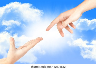 Hand reaching out from the sky