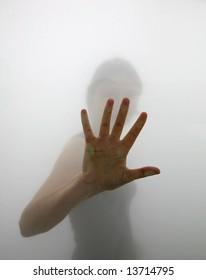 Hand reaching through fog