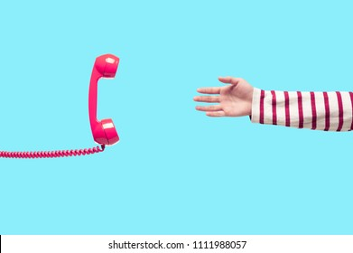 Hand reaching the vintage pink telephone, urgent call waiting , retro pink telephone receiver in pop art style, concepts of help, support, communication