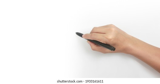 Hand is ready for drawing with black marker