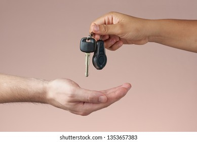 Hand receiving car keys. Receiving or giving car keys. Buying and selling concept. Renting cars concept.