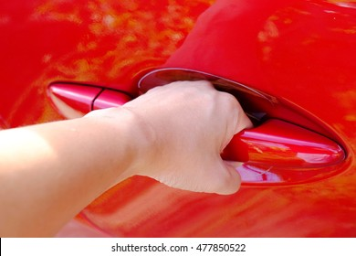 hand of the red car handle