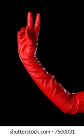 hand in red glove on the black background counting two