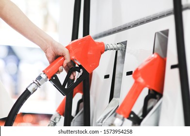 Hand Refueling the car at a gas station.
