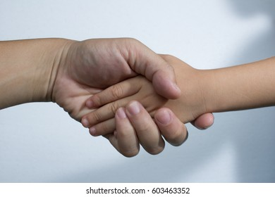 hand and hand for  relation between mom and kids for safe life  mother and son in isolated