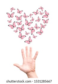 hand releases a flock of butterflies in the shape of a heart. isolated on white background