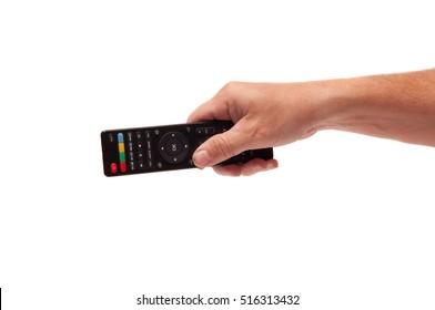 Hand with remote control on white background.